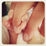 Daddy holds Philos hand